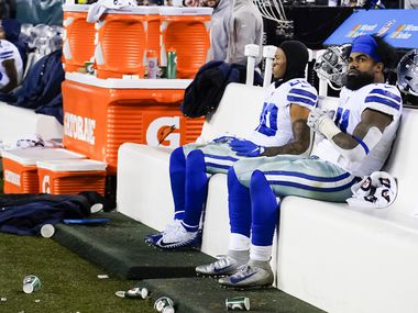 Dallas Cowboys running backs Ezekiel Elliott (21) and Tony Pollard (20) watch from the bench during the second half of an NFL football game against the Philadelphia Eagles at Lincoln Financial Field on Sunday, Dec. 22, 2019, in Philadelphia.