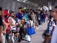People wait in line to cross the border to El Paso, Texas through the Paso Del Norte Port of Entry in Ciudad Juarez, Chihuahua, Mexico, on Friday, June, 26, 2020. (Joel Angel Juarez/Special Contributor)