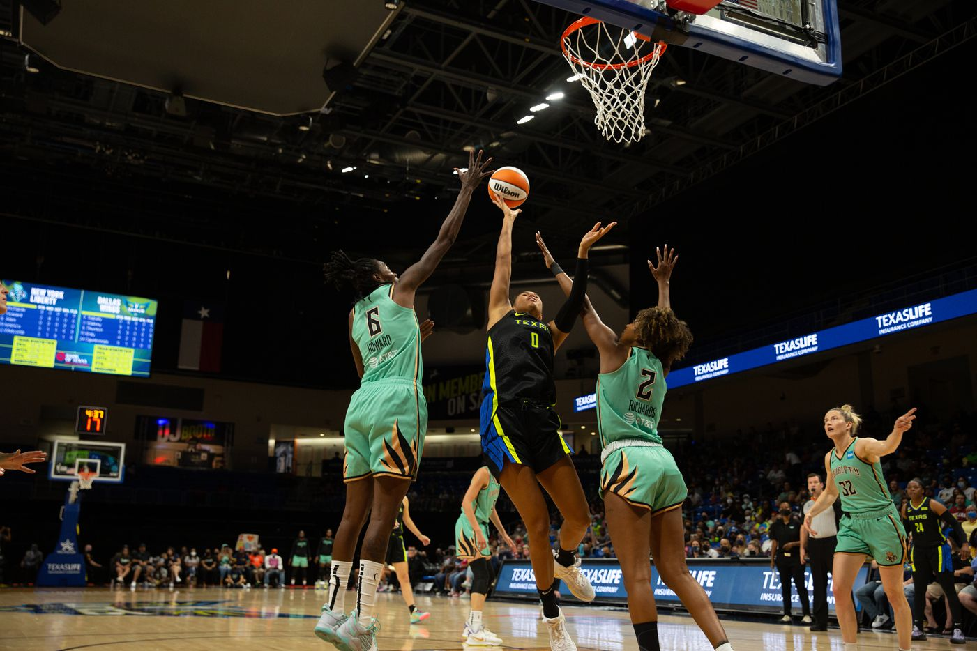Dallas Wings forward Satou Sabally (0) drives up for a shot during their game against New York Liberty at College Park Center in Arlington, TX on September 11, 2021.  (Shelby Tauber/Special Contributor)