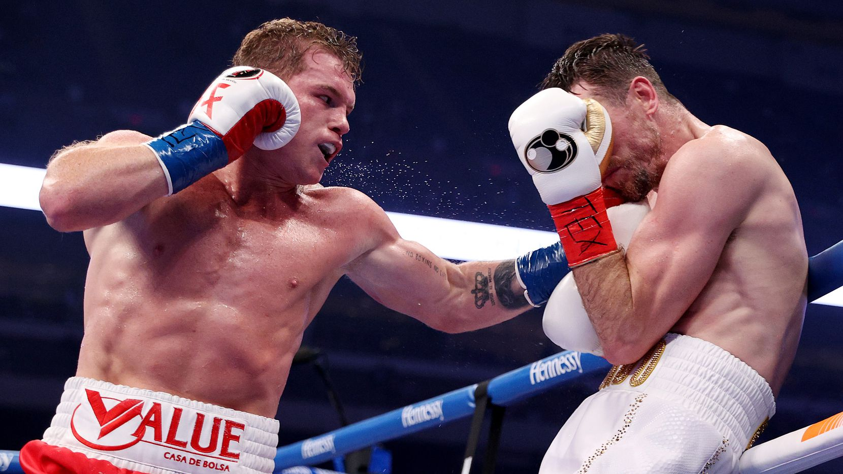 In this handout image provided by Matchroom, Canelo Alvarez punches Callum Smith during their super middleweight title bout at the Alamodome on December 19, 2020 in San Antonio, Texas.