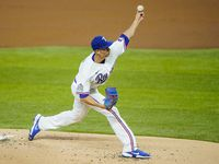 Texas Rangers pitcher Mike Minor pitches during the first inning against the Colorado Rockies at Globe Life Field on Saturday, July 25, 2020.