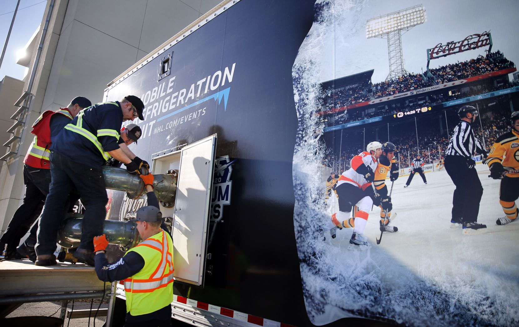 Workers assemble parts of the Mobile Refrigeration Unit which will freeze and keep the ice frozen for the New Year's Day Winter Classic hockey game at Fair Park in Dallas, Tuesday, December 17, 2019. According to the NHL, the 53-foot trailer is the world's largest mobile refrigeration unit. It houses a state-of-the-art ice-making and ice-monitoring equipment used to create an NHL-caliber sheet of ice. The annual game will pit the Dallas Stars against the Nashville Predators at the Cotton Bowl. (Tom Fox/The Dallas Morning News)
