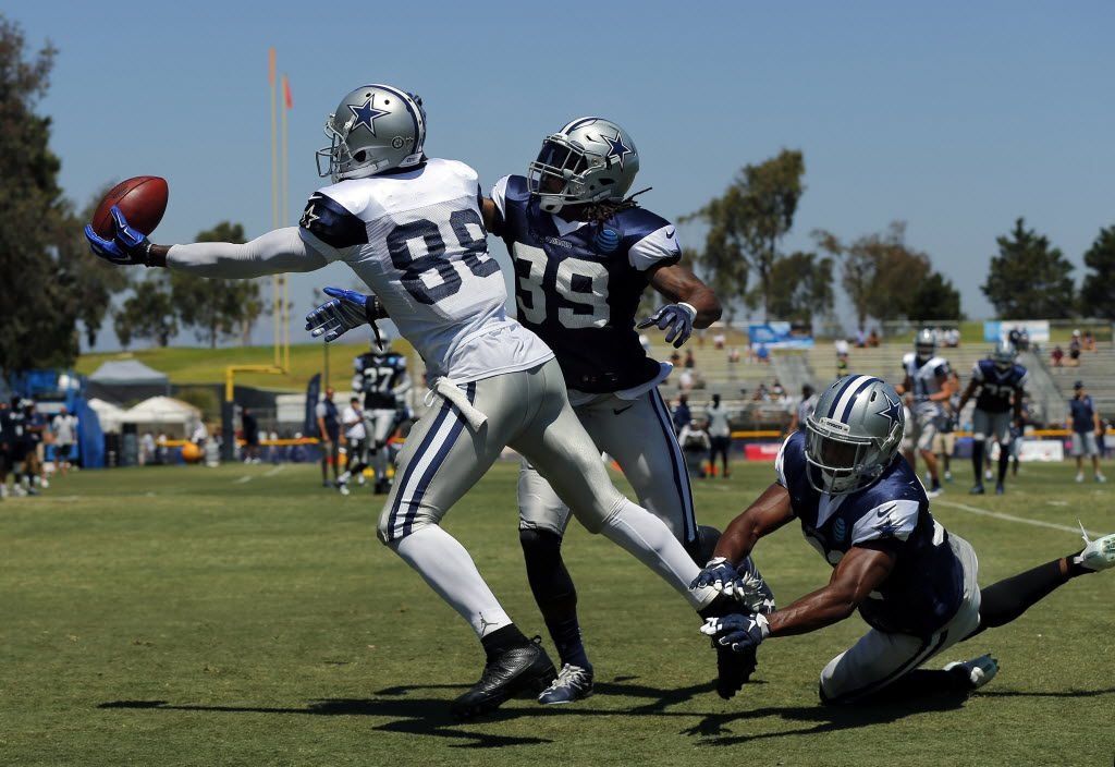 Dallas Cowboys wide receiver Dez Bryant (88) makes a one handed catch in the end zone as he was covered by Dallas Cowboys cornerback Brandon Carr (39) and free safety Byron Jones (31) during morning practice at training camp in Oxnard, California, Thursday, August 11, 2016. (Tom Fox/The Dallas Morning News)