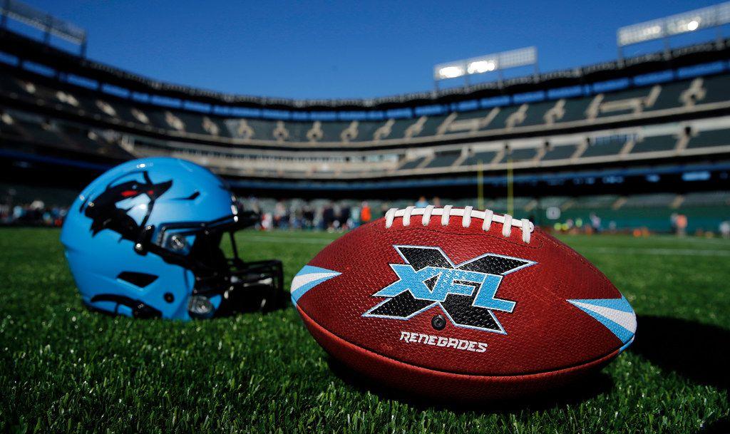 The XFL's Dallas Renegades football team helmet and football on the newly constructed football field at Globe Life Park in Arlington, Texas, Saturday, February 1, 2020. (Tom Fox/The Dallas Morning News)