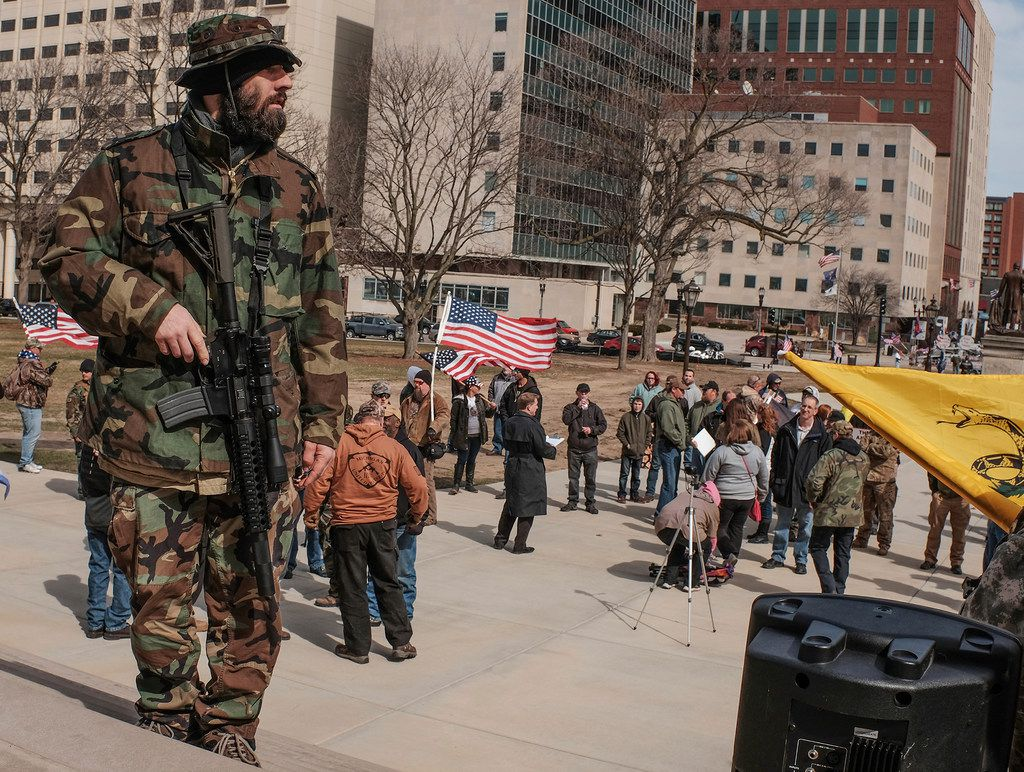 A man openly carries a weapon during a pro-Second Amendment rally at the State Capitol in Lansing, Mich. to counter a March for Our Lives event that happened a few hours earlier.