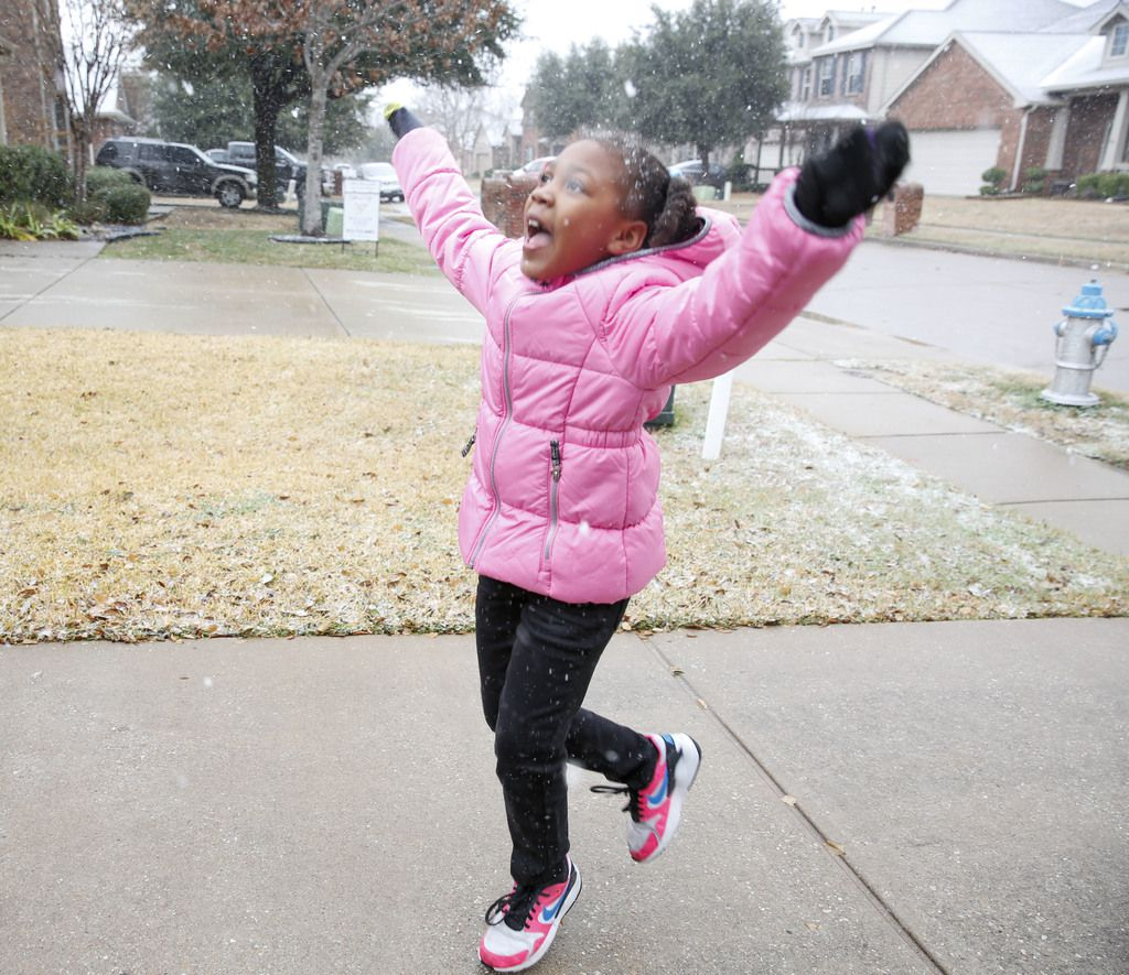 6-year-old Dasiya Small jumps with excitement as it snows in McKinney, Texas Saturday January 11, 2020. (Brian Elledge/The Dallas Morning News)