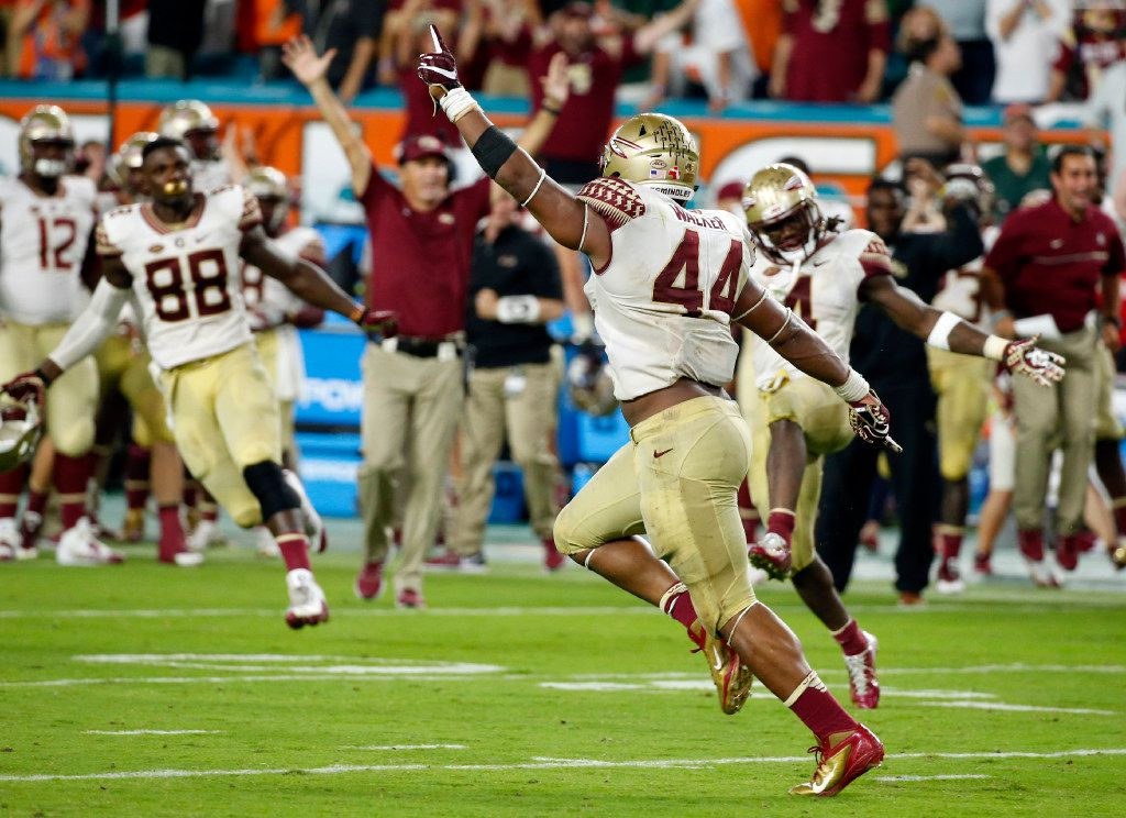 Florida State defensive end DeMarcus Walker (44) celebrates after blocking a field goal during the second half of an NCAA college football game against Miami, Saturday, Oct. 8, 2016, in Miami Gardens. Florida State defeated Miami 201-19. (AP Photo/Wilfredo Lee)