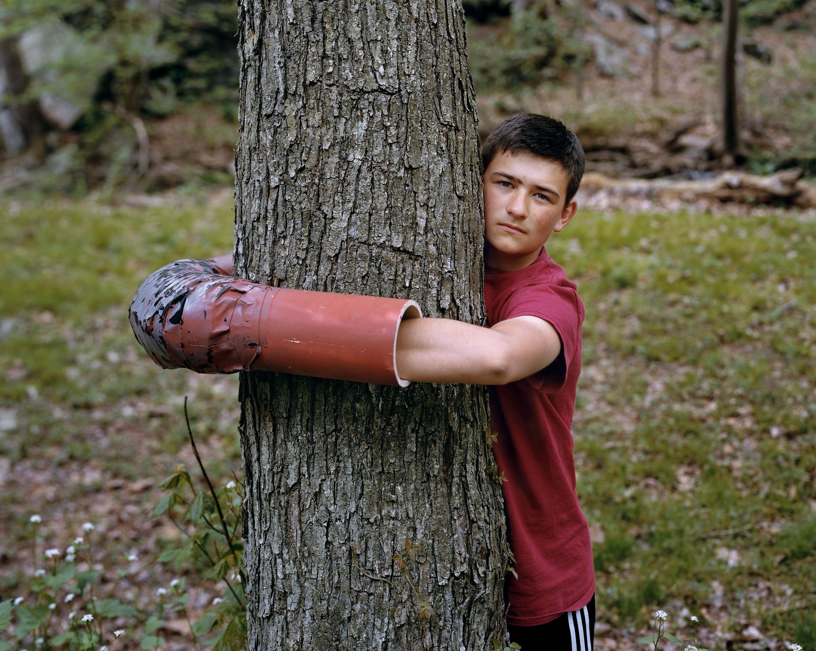 """""""Ashton Clatterbuck, Lancaster County, Pennsylvania 2018"""" captures a young activist who attached himself to a tree to try to prevent the construction of a natural-gas pipeline."""