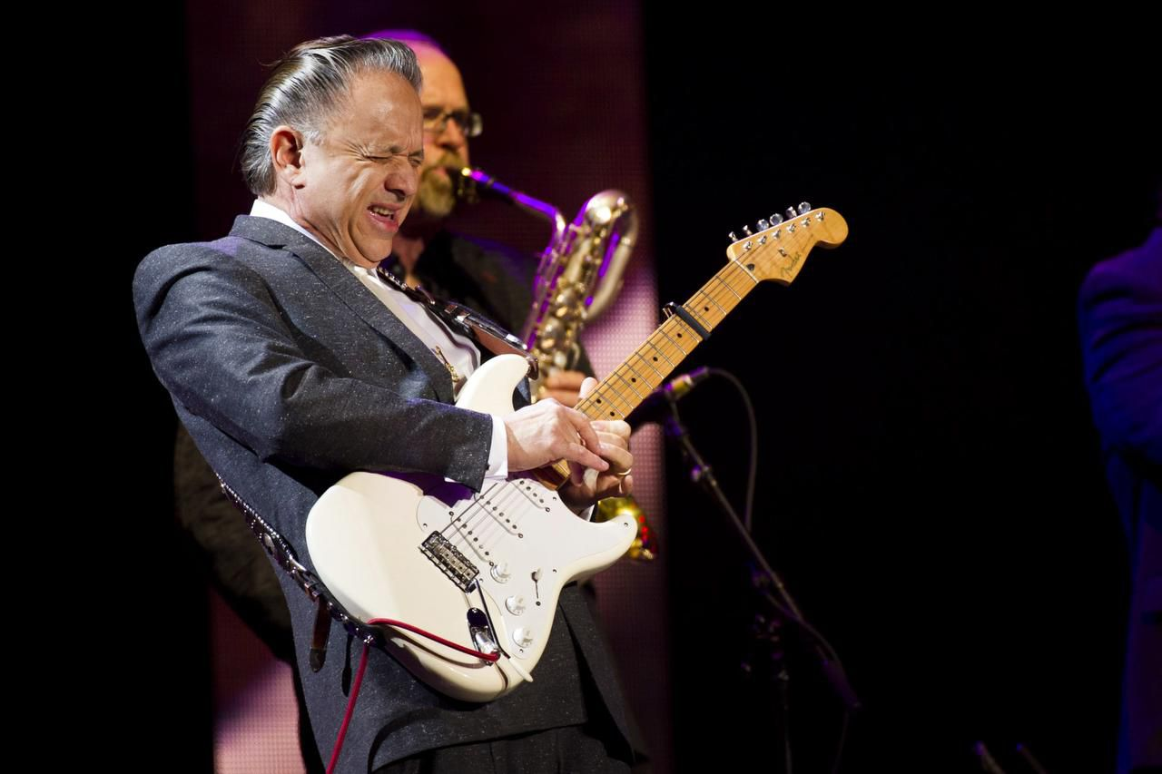 In this 2013 file photo, Jimmie Vaughan performs at Eric Clapton's Crossroads Guitar Festival. Plans are in the works in Dallas for an art piece honoring blues guitarist brothers Stevie Ray and Jimmie Vaughan at a park located just blocks from the home where they grew up in Dallas.