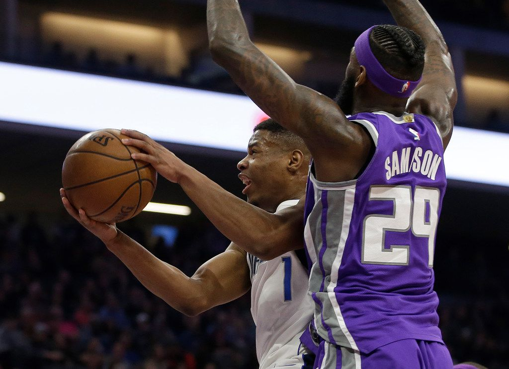 Dallas Mavericks guard Dennis Smith Jr., left, goes to the basket against Sacramento Kings forward JaKarr Sampson during the first half of an NBA basketball game Saturday, Feb. 3, 2018, in Sacramento, Calif. (AP Photo/Rich Pedroncelli)