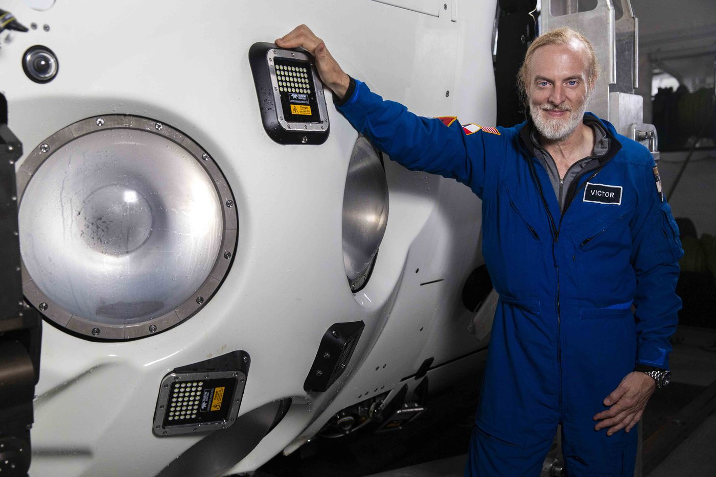 "Victor Vescovo beside his deep ocean submersible ""€˜Limiting Factor"""