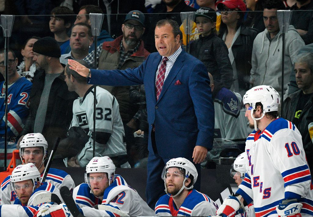 FILE - In this Jan. 21, 2018 file photo, New York Rangers coach Alain Vigneault gestures during the team's game against the Los Angeles Kings in Los Angeles. The Rangers fired Vigneault after missing the playoffs in his fifth season. (AP Photo/Michael Owen Baker, File)