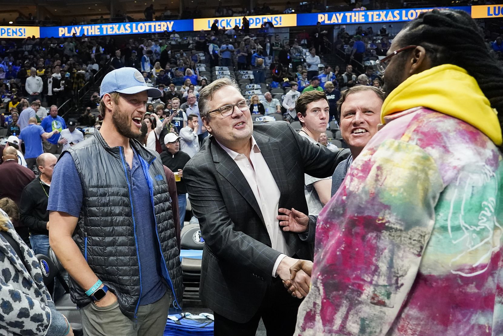 Dallas Mavericks general manager Donnie Nelson shakes hands with rapper 2 Chainz as Los Angeles Dodgers pitcher Clayton Kershaw looks on before an NBA basketball game against the Los Angeles Lakers at American Airlines Center on Friday, Jan. 10, 2020, in Dallas.