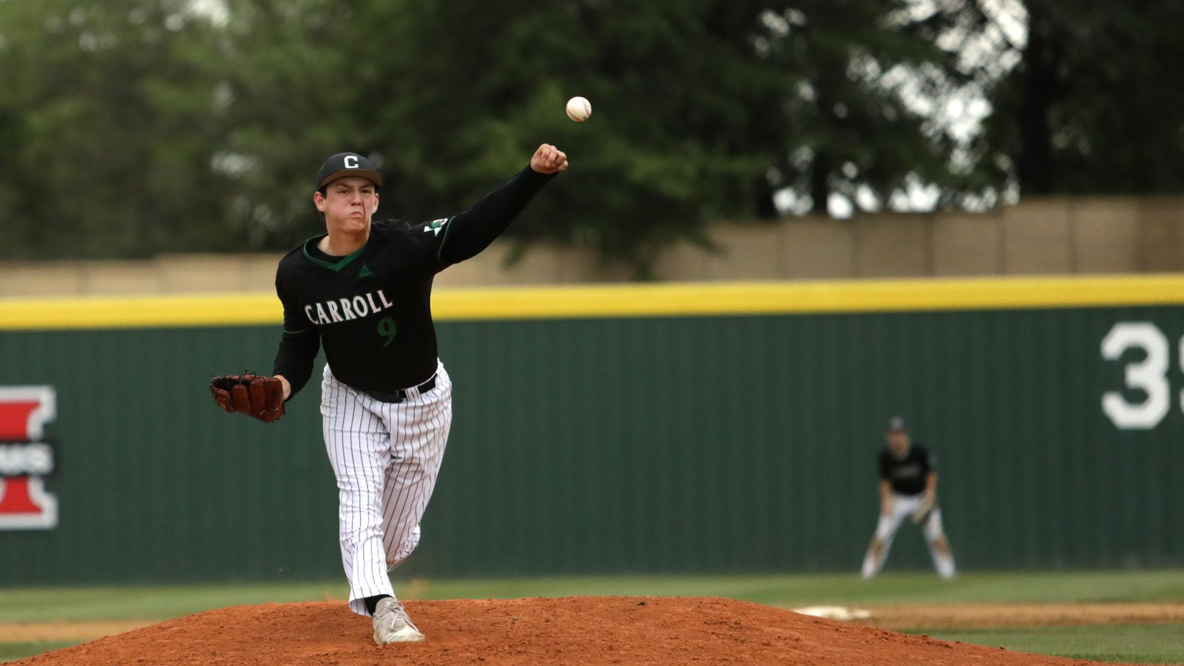 Southlake Carroll High School player #9, Owen Proksch, pitches during a baseball playoff game at the Flower Mound Marcus High School baseball field in Flower Mound, TX, on May 28, 2021.