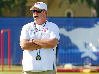FILE - SMU head coach Sonny Dykes is pictured during football practice on campus in Dallas on Saturday, Aug. 4, 2018.