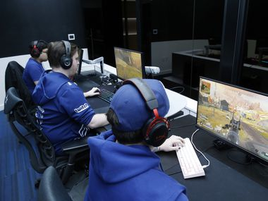 """The Complexity Gaming Apex Legends Bowen """"Monsoon"""" Fuller (right) competes in Apex Legends with his teammates Ryan """"Meerko"""" Amato (center), and Ryan """"Reptar"""" Boyd (left) at Complexity Gaming headquarters inside the GameStop Performance Center at The Star, in Frisco on Thursday, March 5, 2020. The team was practicing in preparation for the Apex Legends Global Series Major in Arlington, March 13-15."""