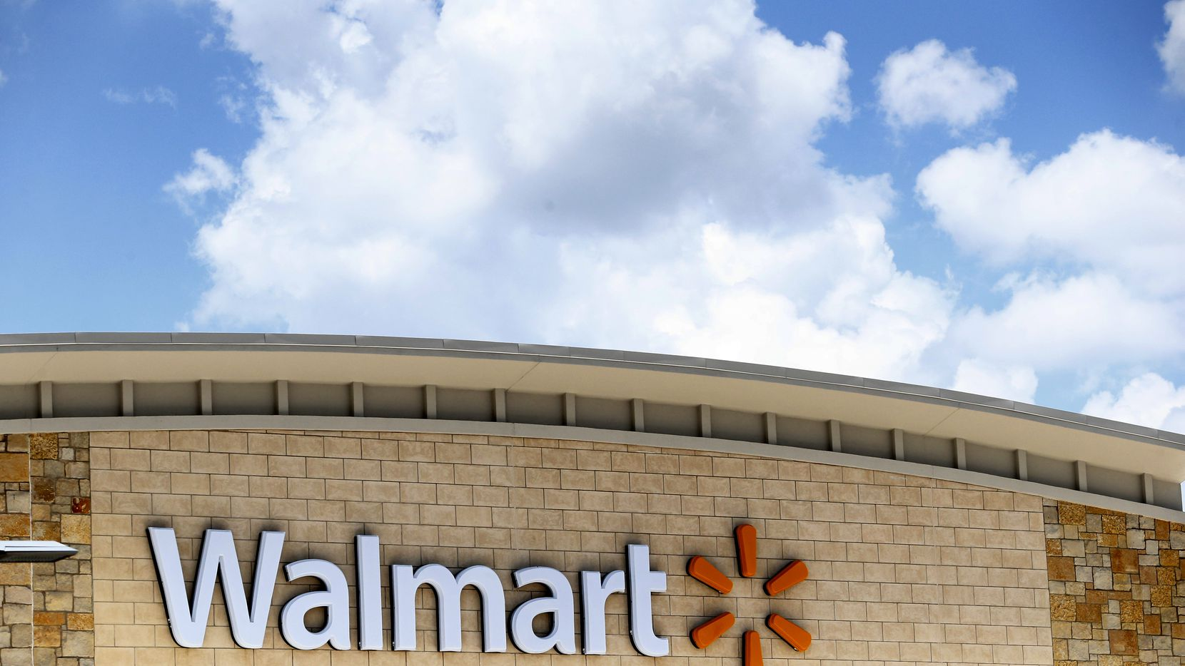An exterior shot of the Walmart sign at Timber Creek Crossing in Dallas.