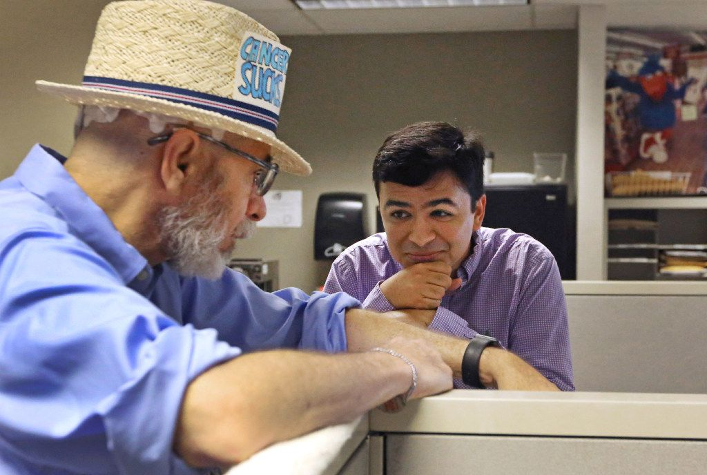 """Jeffrey Weiss talks with Andrew Chavez as he makes the rounds at The Dallas Morning News in what has unofficially been dubbed """"Thursdays with Jeffrey."""" Weiss keeps working in the newsroom and mentoring journalists even as he battles brain cancer."""