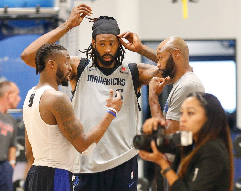 Dallas Mavericks center DeAndre Jordan (center) listens in on a conversation with assistant coach Jamahl Mosley (right) and Wesley Matthews at their practice facility in Dallas, Monday, September  24, 2018. (Tom Fox/The Dallas Morning News)