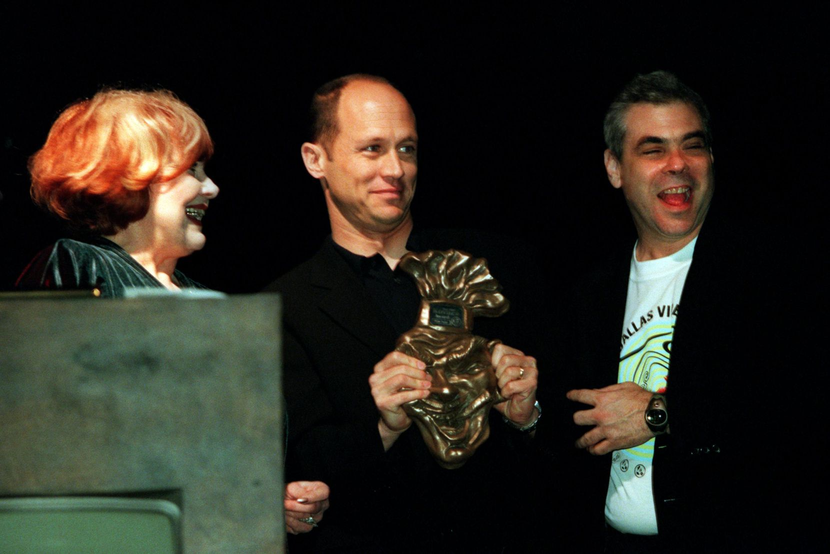 """Mike Judge  (center), creator of """"Beavis and Butt-Head,"""" """"King of the Hill"""" and """"Office Space,"""" receiving the Ernie Kovacs Award from Edie Adams, Kovacs' widow, and Dallas Video Festival director Bart Weiss at the 14th annual festival."""