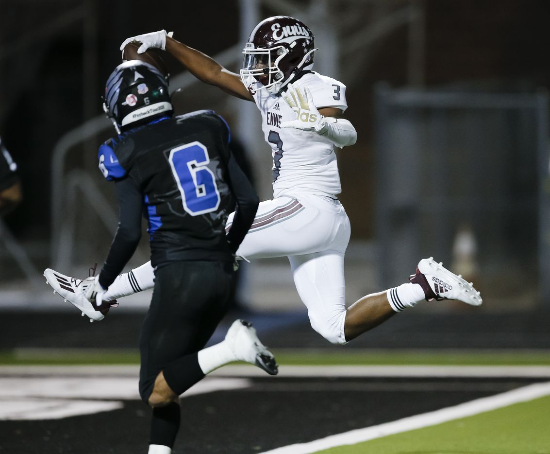 Ennis junior running back De?ivian Johnson (3) scores a touchdown as North Forney senior defensive back Jeremy Bailey (6) defends during the second half of a high school playoff football game in Forney, Thursday, November 19, 2020. Ennis won 38-14. (Brandon Wade/Special Contributor)