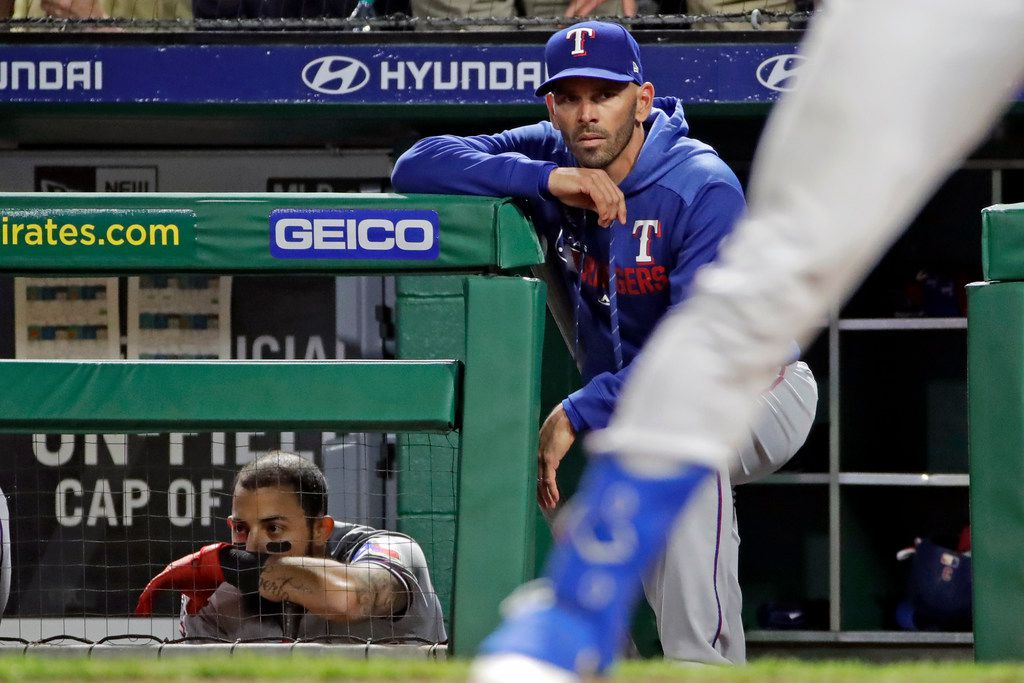 Texas Rangers manager Chris Woodward, center, stands on the dugout steps next to Rougned Odor, left, as he watches Joey Gallo in the final at-bat of his team's baseball game against the Pittsburgh Pirates in Pittsburgh, Tuesday, May 7, 2019. Pittsburgh Pirates relief pitcher Felipe Vazquez struck out Gallo to get the save in the 5-4 Pirates' win. (AP Photo/Gene J. Puskar)