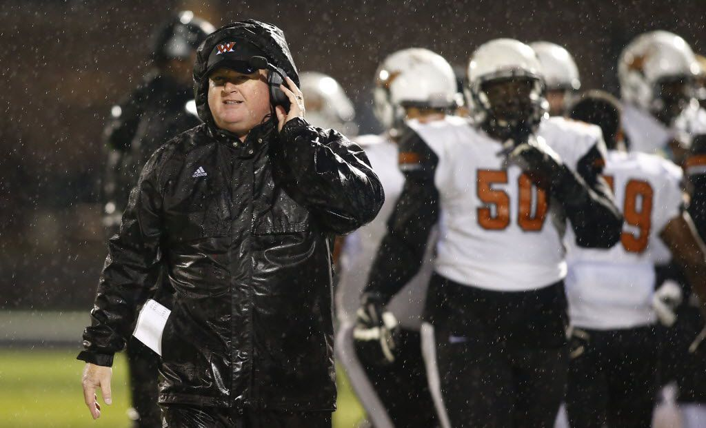 TXHSFB West Mesquite head coach Jeff Neill walks along the sideline in the first half of their high school football game against Forney in Forney, Texas, Friday, October 30, 2015. Mike Stone/Special Contributor