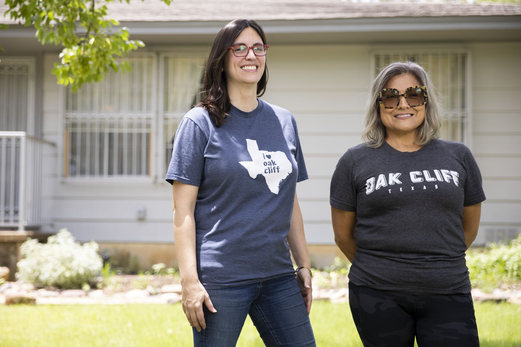 """Christine Hopkins (left) and Yolanda Alameda outside of Alameda's Oak Cliff home. Alameda, a task force member, says, """"My fear is that this kind of planning could change the face of the neighborhoods — the blanket loss of longtime people, their residences, small businesses."""""""