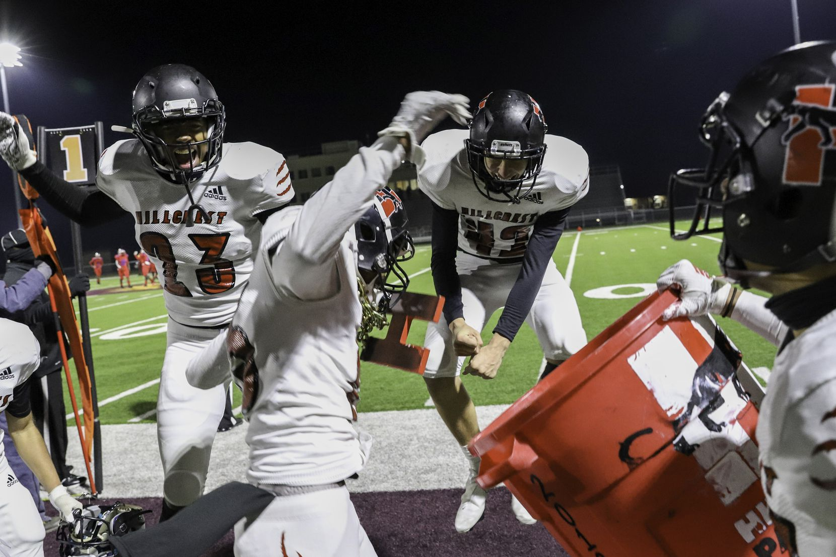 Hillcrest defensive back Donald Olusegun (15) celebrates a turnover with linebackers Jakobi Hardy (23) and Wesley Morris (42) during the second half against Spruce at James Ray Henry Stadium in Seagoville, Texas, Friday, December 4, 2020. (Elias Valverde II / Special Contributor)