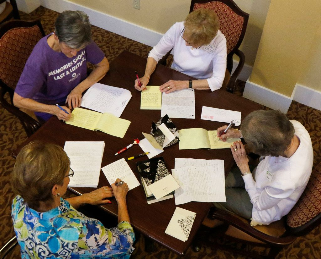 From top left, Pam Davidson, Kathy Rotto, Gloria Box and Sue Standlee, all residents at Presbyterian Village North in Dallas, write to third-grade students in Karen Gunter's class at Good Shepherd Episcopal School on Monday, March 19, 2018. (David Woo/The Dallas Morning News)