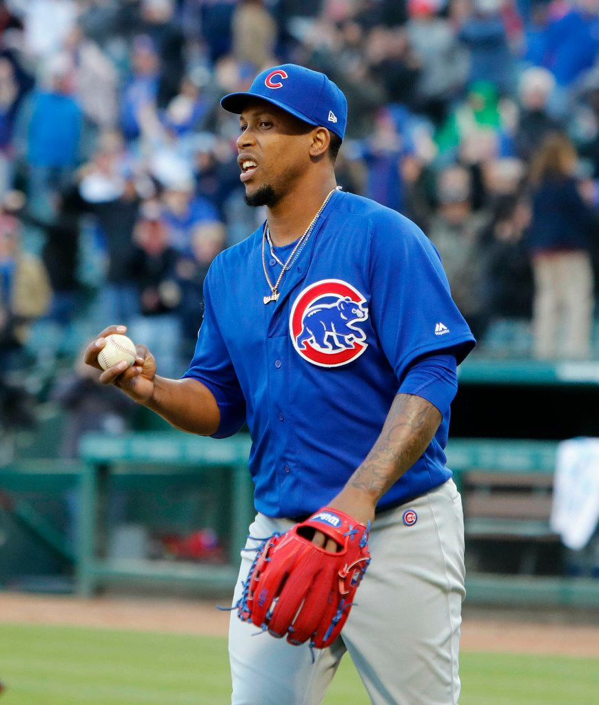 Chicago Cubs Pedro Strop holds the game ball during the ninth inning against the Texas Rangers in Arlington, Texas, Sunday, March 31, 2019.