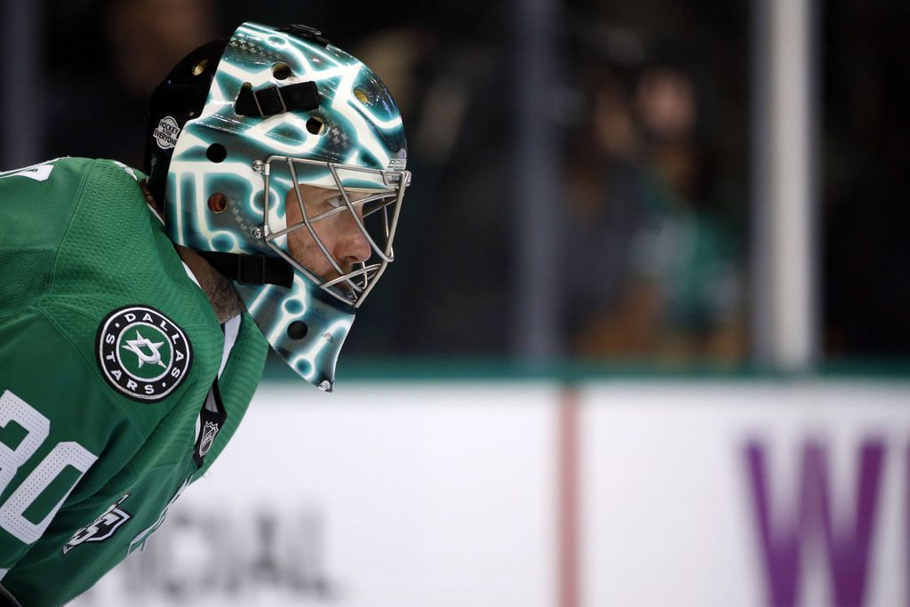 Dallas Stars goaltender Ben Bishop (30) defends against the Vancouver Canucks during the second period of an NHL hockey game in Dallas, Sunday, Feb. 11, 2018. (AP Photo/Michael Ainsworth)
