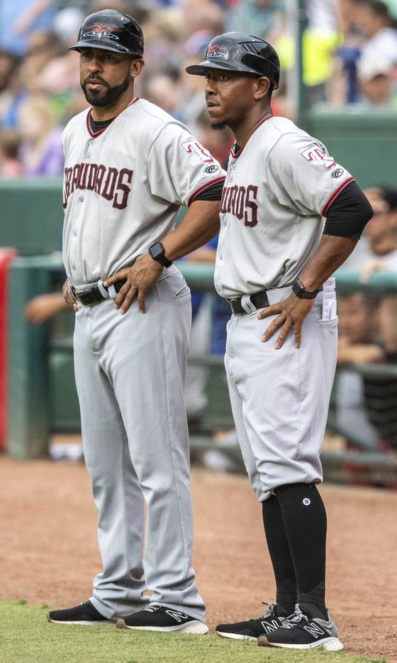 Hickory Crawdad's coach Hiram Bocachica and manager Joshua Johnson talk during the game with the Greensboro Grasshopper's at First National Bank Field on Friday, August 6, 2021 in Greensboro, N.C. (Woody Marshall/Special Contributor)