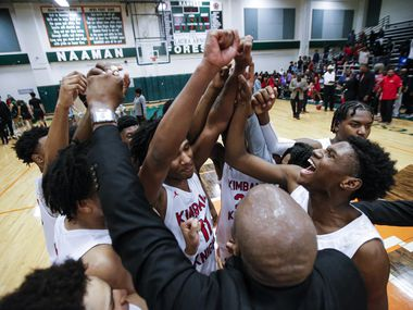 Kimball celebrates a 101-73 win over Newman Smith after a Class 5A Region II quarterfinal boys basketball game at Naaman Forest High School in Garland, Tuesday, March 3, 2020.