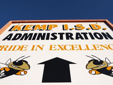 A state investigation into allegations of bribery, threats of violence and racist remarks in Kemp ISD is stalled in court.