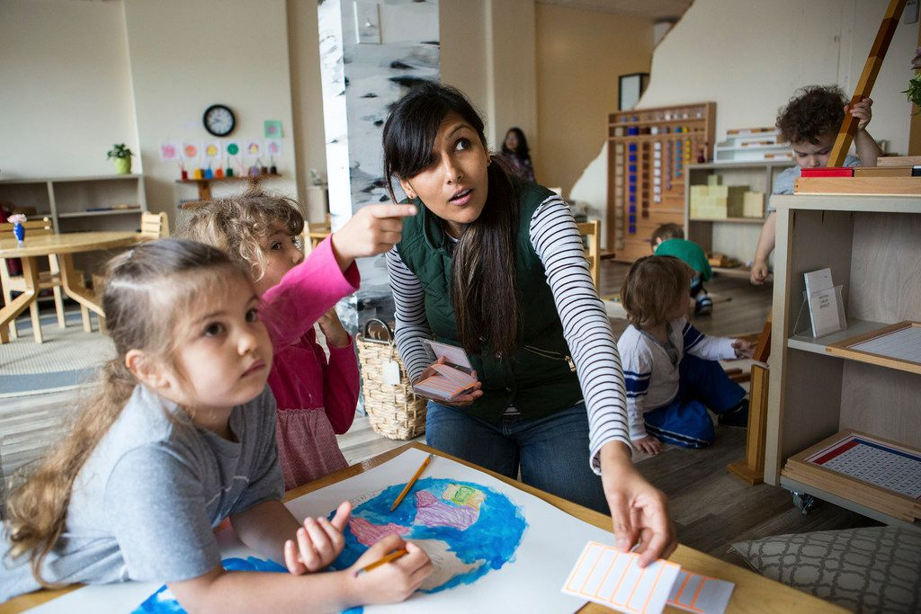 Kanan Patel, a teacher at the Aster Montessori School in Cambridge, Mass., with students, in May, 2017. In September 2018 Jeff Bezos announced he would start a network of Montessori preschools.