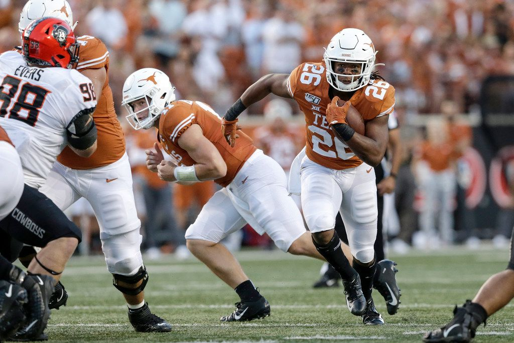 Texas running back Keaontay Ingram, No. 26, runs the ball during the first half of the Longhorns' win over  the Oklahoma State Cowboys at Darrell K Royal-Texas Memorial Stadium on September 21, 2019 in Austin, Texas.  (Photo by Tim Warner/Getty Images)