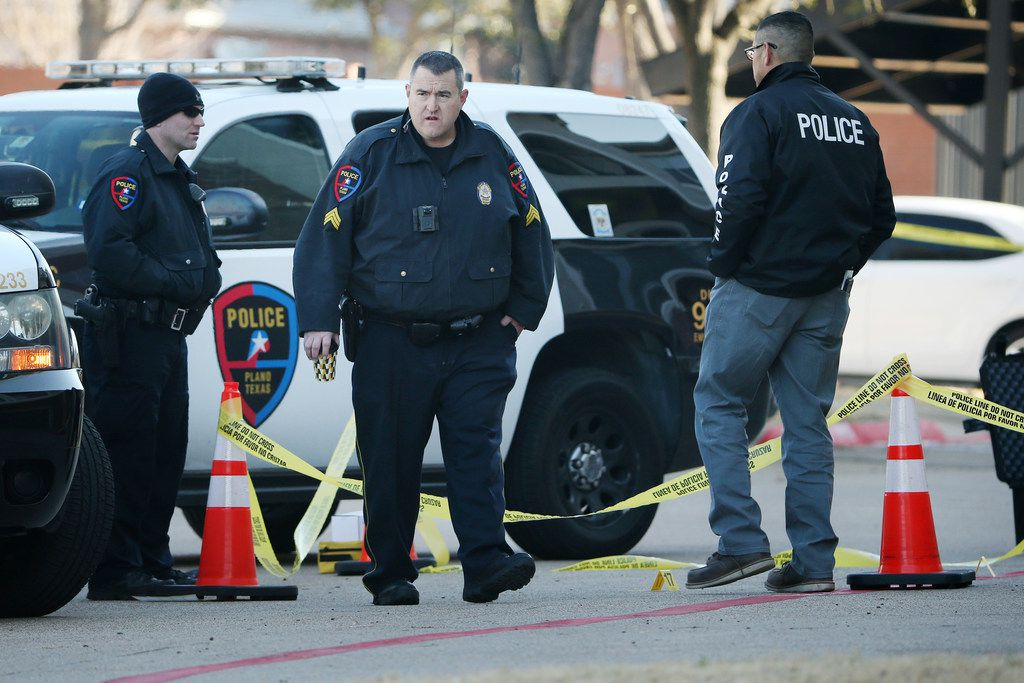 Authorities work near where they suspect Brandon McCall shot an officer the day before at the Breckinridge Point apartment complex in Richardson, Texas Thursday, February 8, 2018.