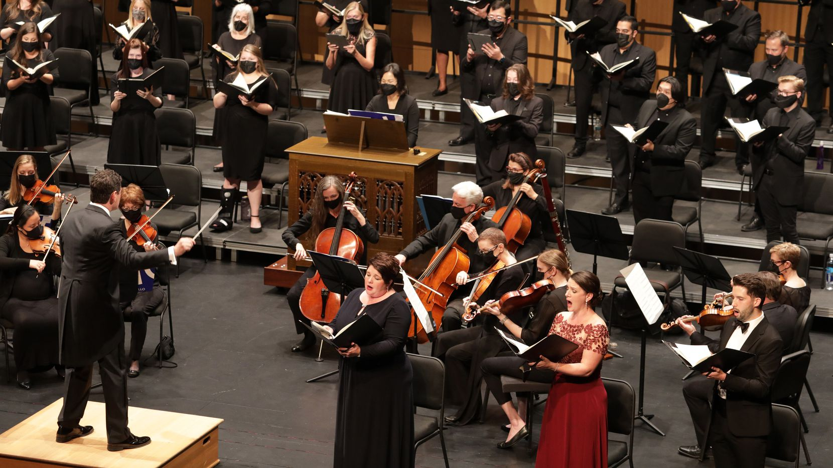 Gregory Hobbs conducts the Highland Park Chorale and Orchestra, with (from left) soprano Julie Liston Johnson, alto Claire Shackleton and tenor Barrett Radziun, at Moody Performance Hall in Dallas on Sept. 11, 2021.
