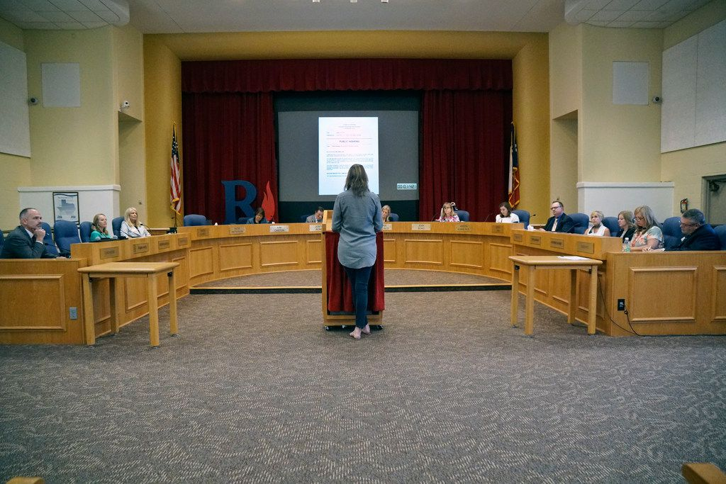 Richardson ISD school board members listen to a speaker during a meeting at the administration building on Monday.