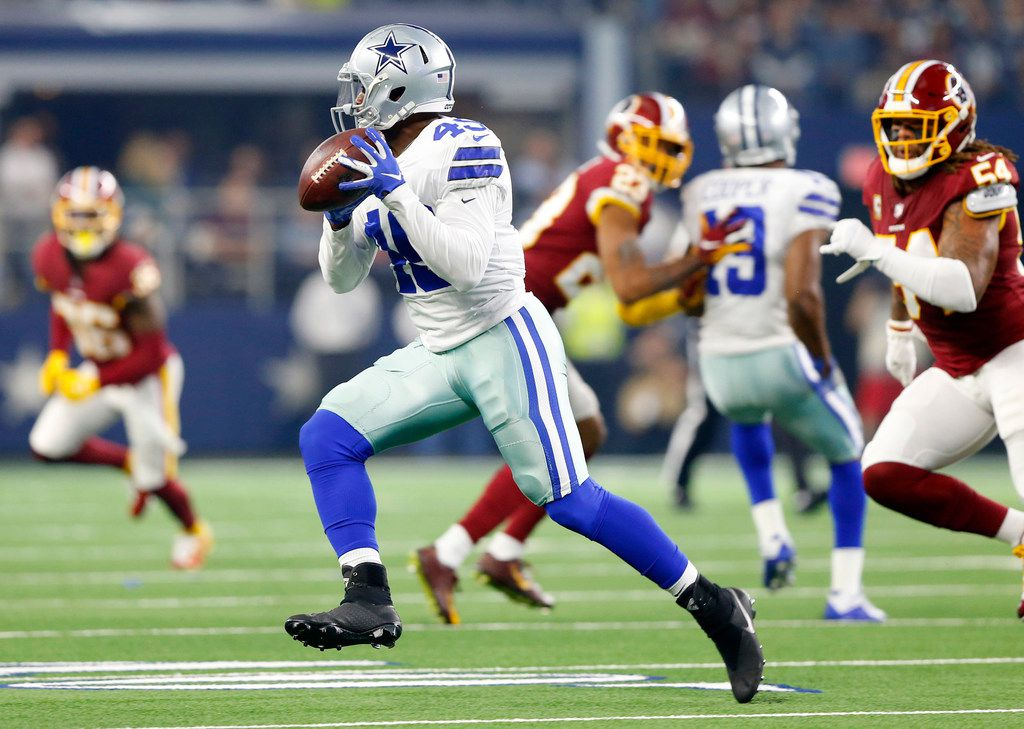 Dallas Cowboys running back Jamize Olawale (49) makes a first quarter reception and turns up field against the Washington Redskins at AT&T Stadium in Arlington, Texas, Thursday, November 22, 2018.