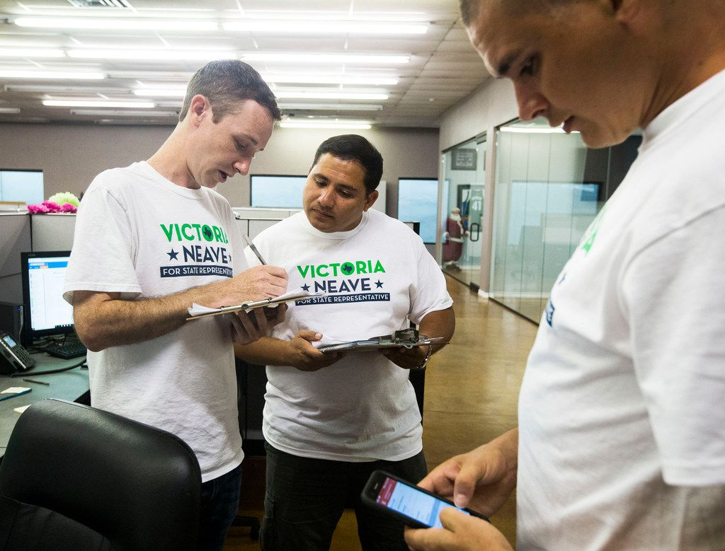From left: Huntley Russell, Sergio Gonzales and Matthew Brown, all volunteers, prepare to go knock on doors at Victoria Neave's campaign headquarters in Dallas on Sept. 2, 2018.
