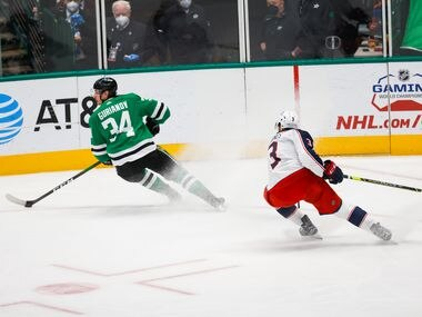 Dallas Stars right wing Denis Gurianov (34) skirts away from Columbus Blue Jackets defenseman Seth Jones (3) in the first period at American Airlines Center in Dallas on Thursday, April 15, 2021.