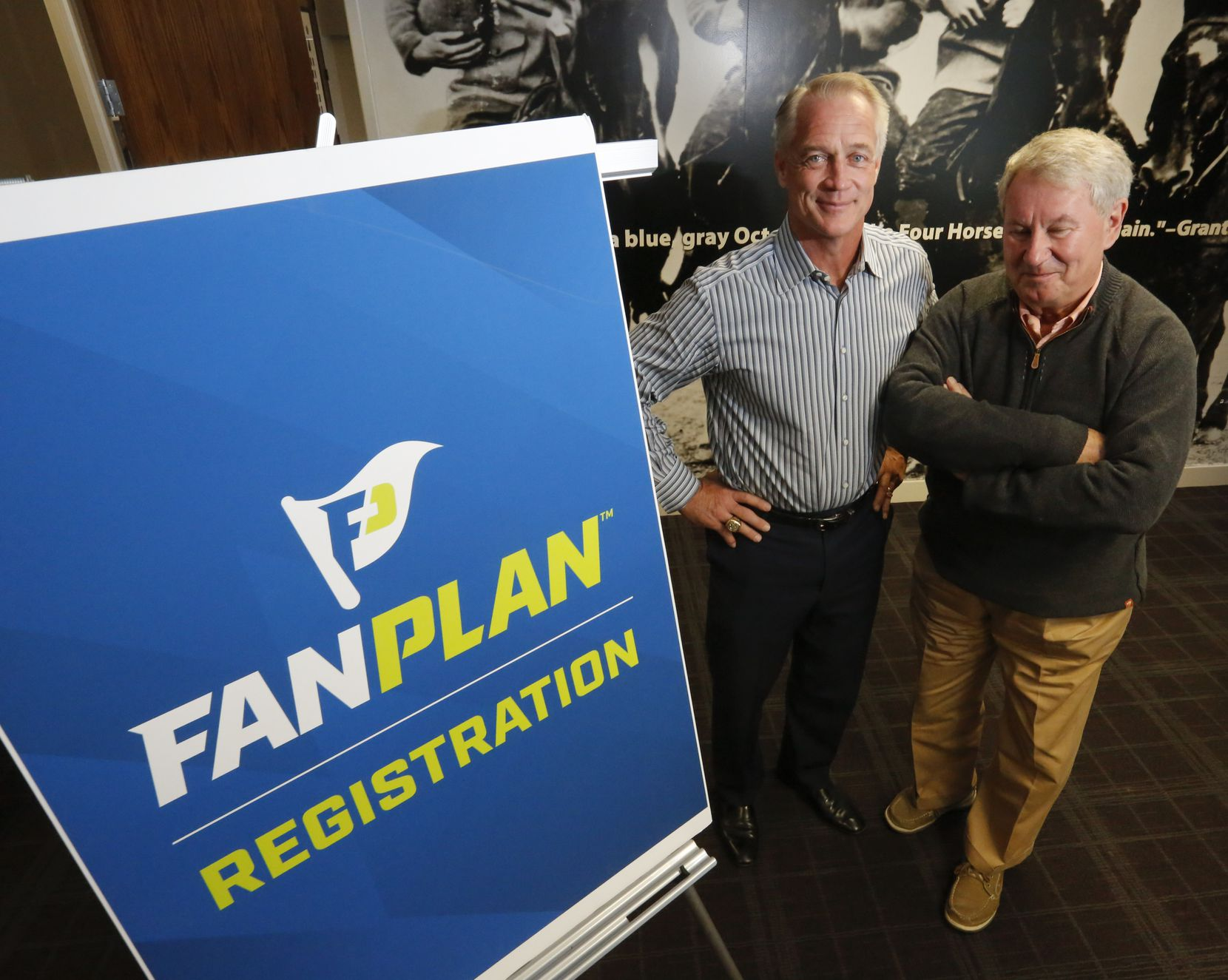 Former Dallas Cowboys fullback Daryl Johnston, left,  and Terry Leiweke, president of Ally Sports Group, are offering college football fans an indemnity plan called Fan Plan, that offers price protection if their teams make it to the football championship.