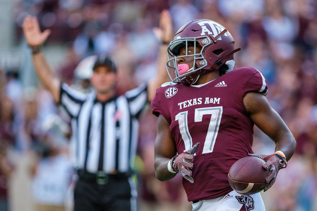 FILE - Texas A&M wide receiver Ainias Smith (17) celebrates after scoring on a 15-yard touchdown reception during the second half of a game against Auburn at Kyle Field on Saturday, Sept. 21, 2019, in College Station.
