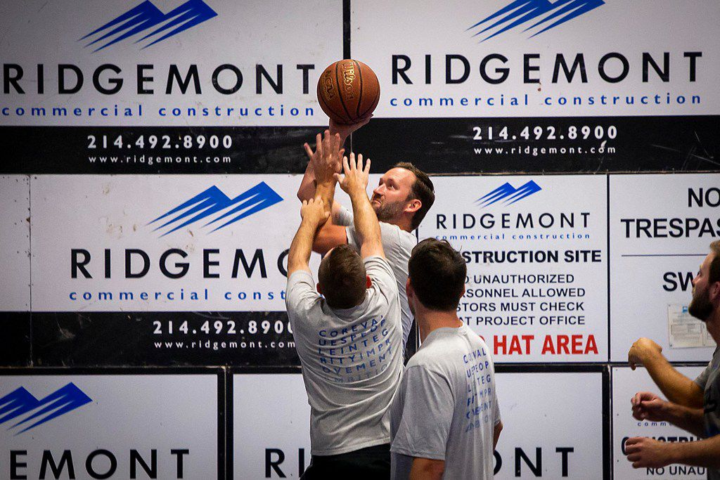 Joey Johnson takes a shot during a regular Wednesday game at Ridgemont including employees, friends and business partners.