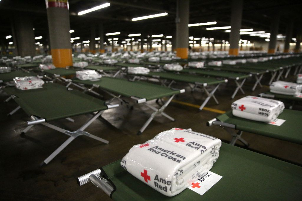 """American Red Cross blankets and beds are set up to house up to 5,000 Gulf Coast residents inside the """"mega shelter"""" at the Kay Bailey Hutchison Convention Center in Dallas on Monday, Aug. 28, 2017. Flooding from tropical storm Harvey has displaced many residents throughout the Texas Gulf Coast."""
