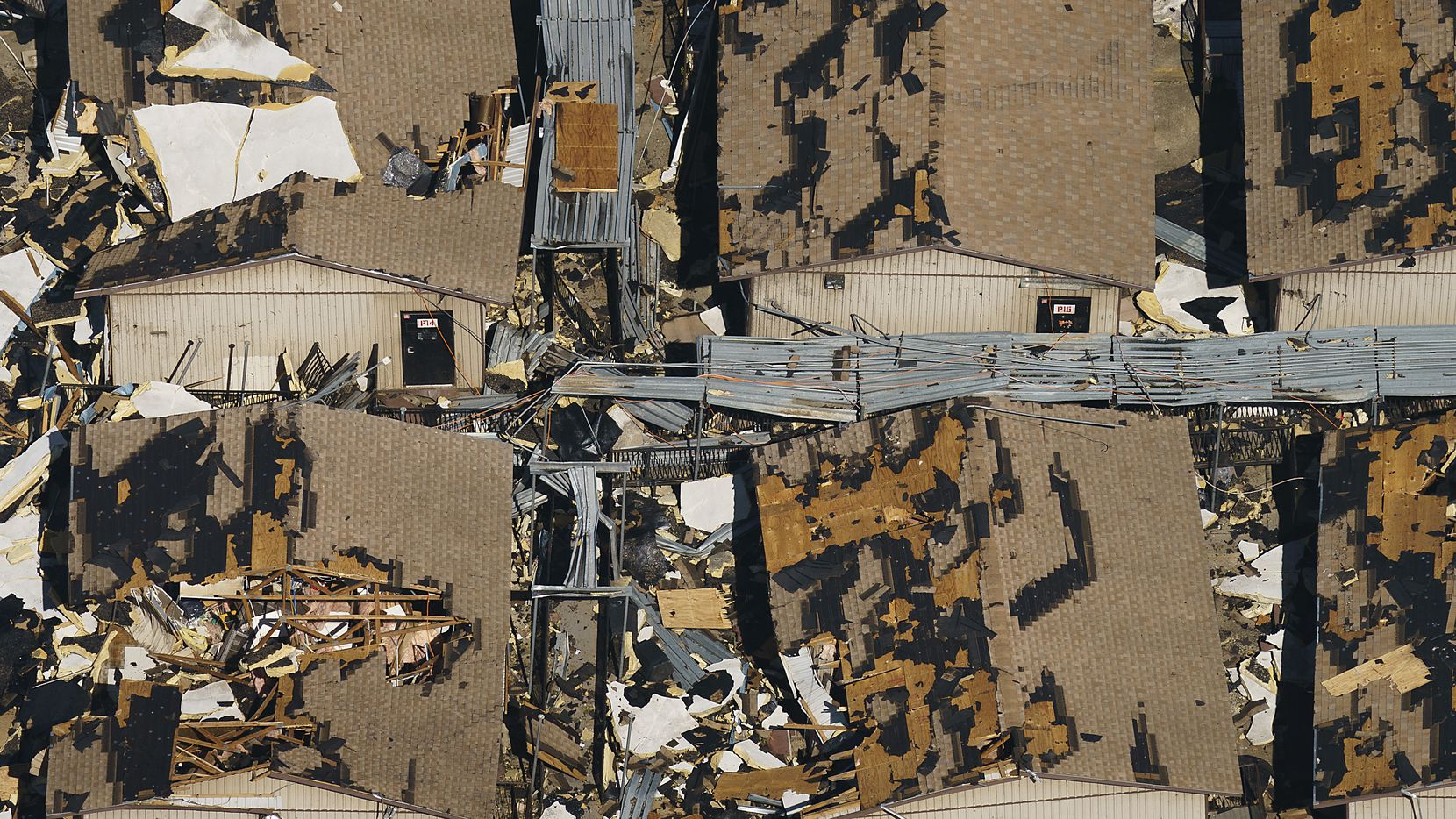 Temporary classroom are seen buried in rubble at Thomas Jefferson HIgh School in an aerial view of tornado damage on Monday, Oct. 21, 2019, in Dallas.