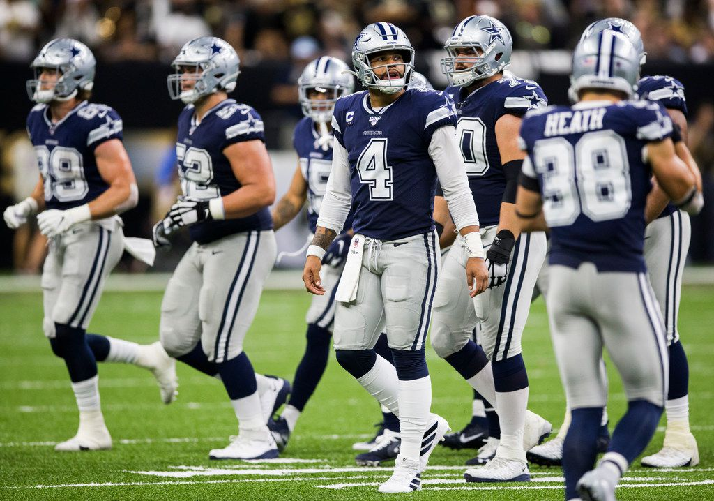 Dallas Cowboys quarterback Dak Prescott (4) looks up at the video board during the second quarter of an NFL game between the Dallas Cowboys and the News Orleans Saints on Sunday, September 29, 2019 at Mercedes-Benz Superdome in New Orleans, Louisiana.