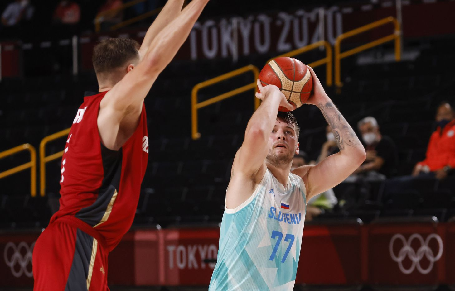 Slovenia's Luka Doncic (77) shoots over Germany's Johannes Voigtmann (7) during the second half of play of a quarter final basketball game at the postponed 2020 Tokyo Olympics at Saitama Super Arena, on Tuesday, August 3, 2021, in Saitama, Japan. Slovenia defeated Germany's 94-70. (Vernon Bryant/The Dallas Morning News)